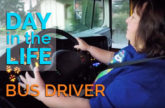 Bus driver driving.