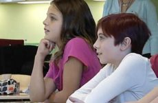 Two students listening to teacher.