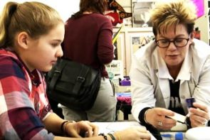 Science teacher working with her student.