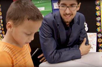 Art teacher helping student