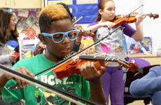 Students playing violins.