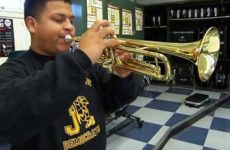 High school student playing trumpet.