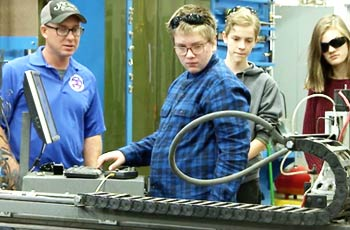 Students working on machine.