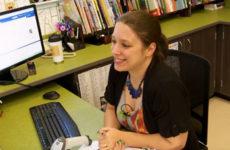 School Librarian, Jessica Esperanza, sitting at her desk.