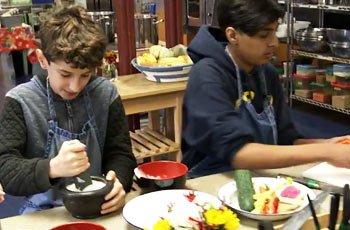 Students preparing food they grew at school.
