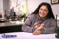 School secretary sitting at desk