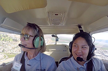Flight instructor with student flying in plane