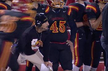 Oakdale High School football coach, Trent Merzon coaching game.