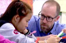 teacher helping refugee student