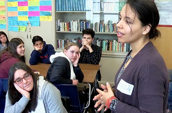 Community speaker talking with Modesto High School students.