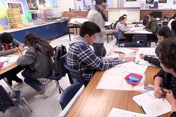 students sitting inside classroom