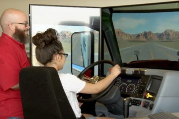 student driving virtual farm equipment