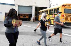 classified support staff walking near bus