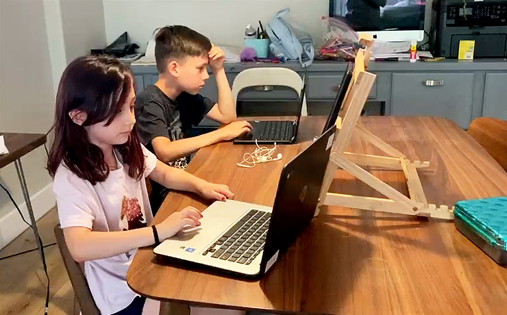 students learning at home on laptops